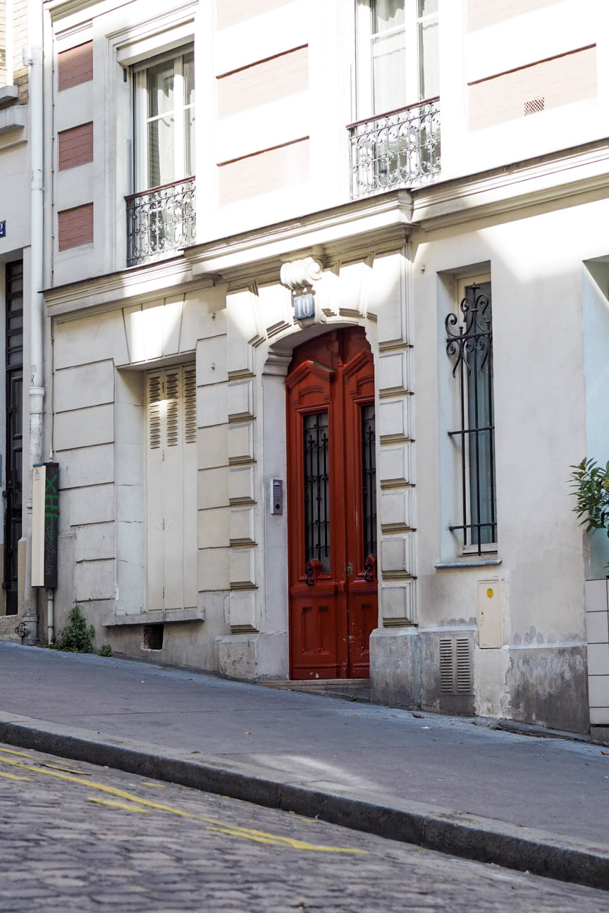Red door of Parisian apartment