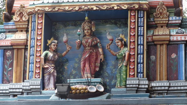A sculpture of Draupadi holding a lotus at the Draupadi Amman Temple, Trichy