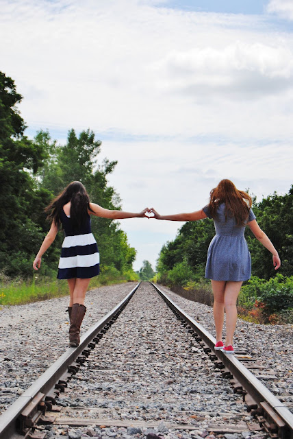 Best Friends walking down a train track while creating a heart between them. #bff #friends #heart #relatable #besties #vibes