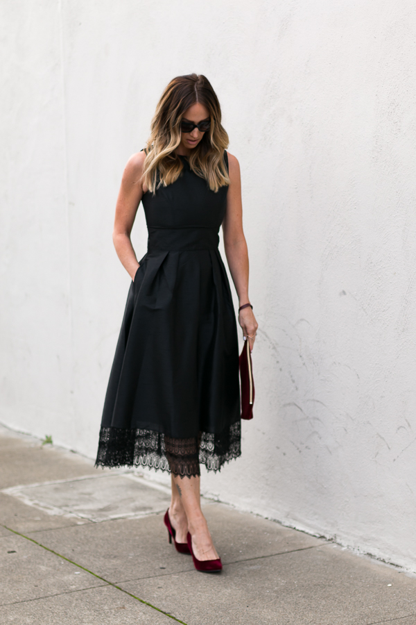 black fit and flare dress with lace trim hem