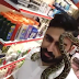 Young Boy Playing With Snake In Mall