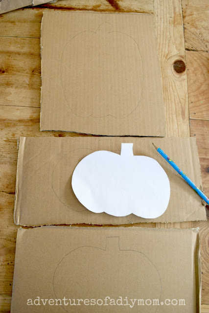 tracing pumpkins on cardboard