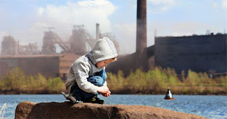 Child near factories (Credit: yaleclimateconnections.org) Click to Enlarge.