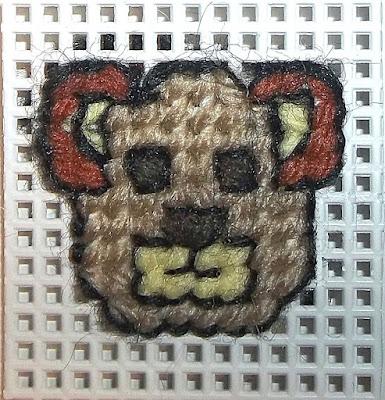 bear's head on plastic canvas