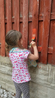helping paint the fence