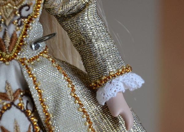 Beading on doll's dress.