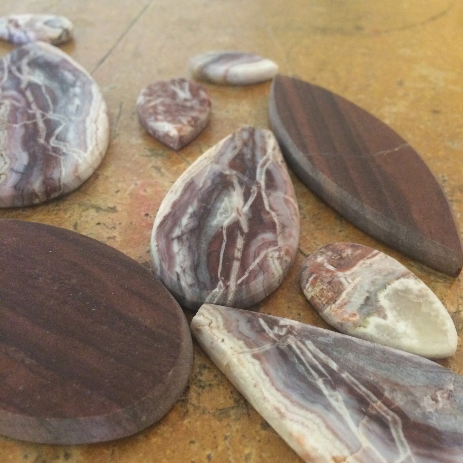 Arizona jasper and Agate cabochons that are partially done