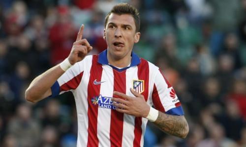 Mario Mandzukic thi đấu cho Atletico Madrid