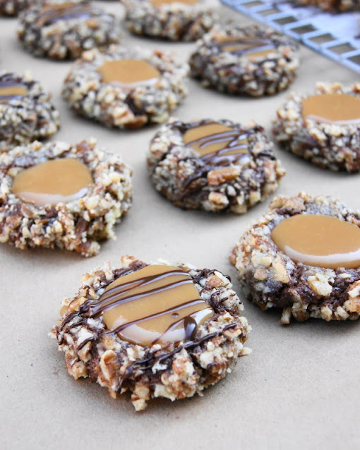 Insanely Delicious Turtle Cookies image ... soft chocolate-pecan thumbprint cookies filled with caramel.  Yum! www.thekitchenismyplayground