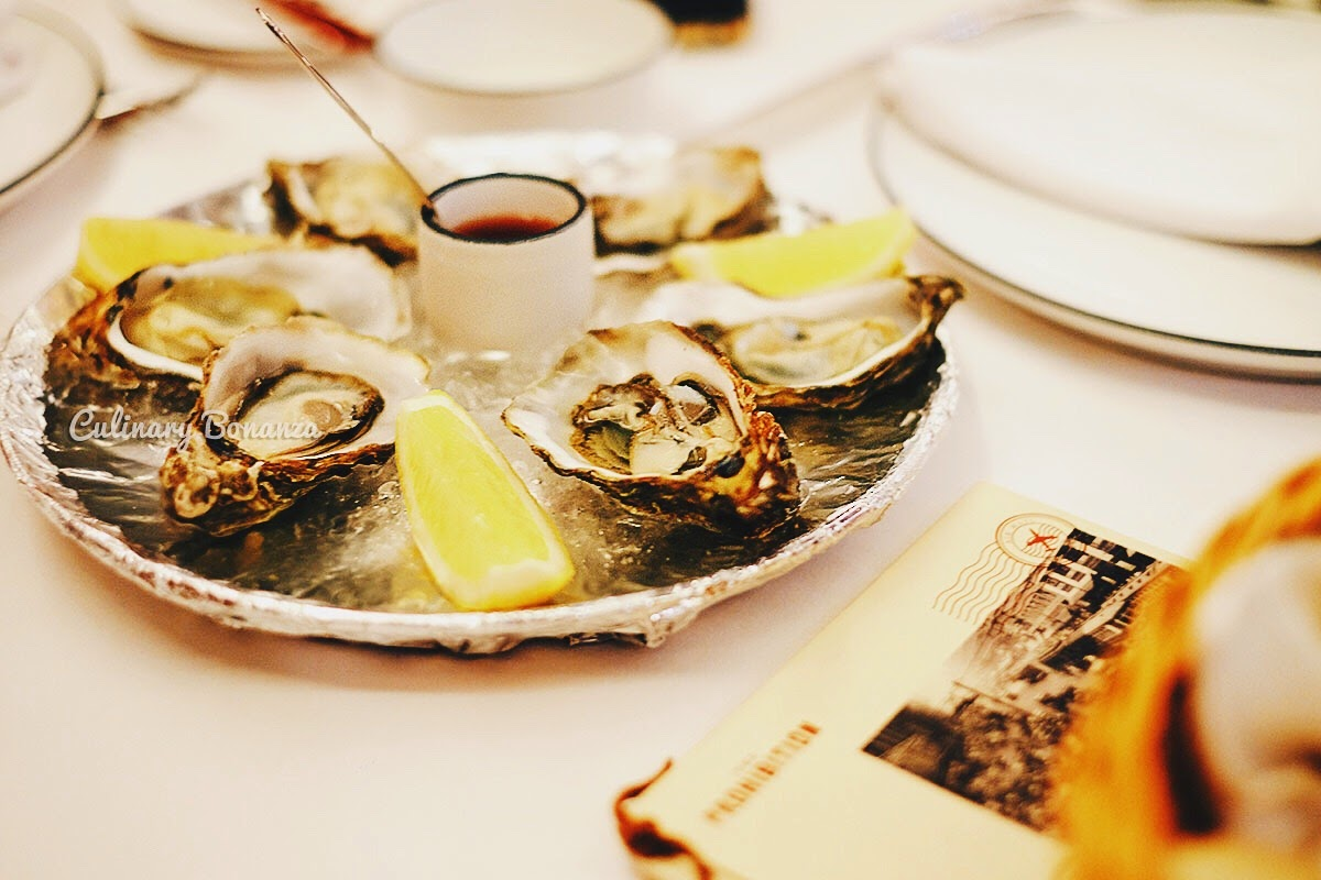 Cold Oysters - served chilled with lemon, shallot vinegar and bread basket (www.culinarybonanza.com)