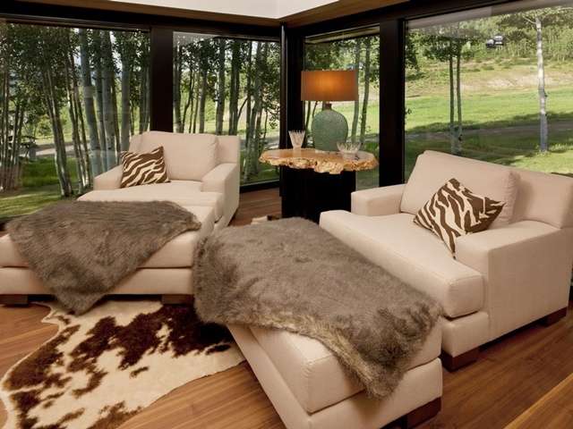 Picture of living room with fur on the furniture