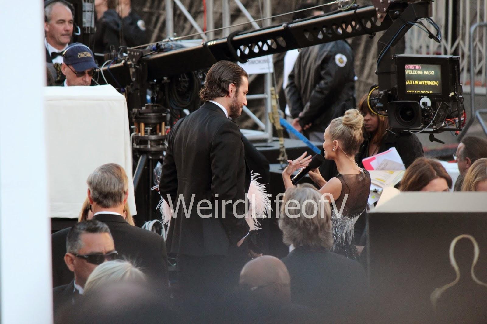 Bradley Cooper being interviewed by Kristin Chenoweth