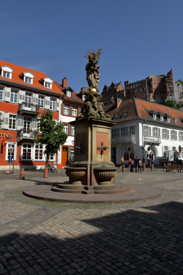 Statue at Marketplatz and Heidelberg Castle in the background