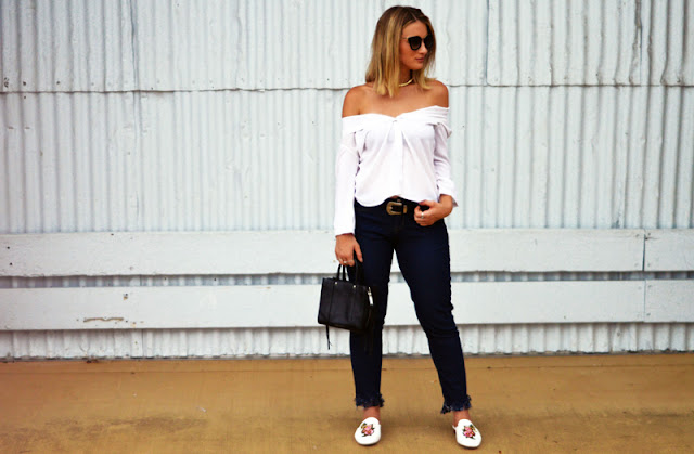 off shoulder white shirt fringe hem jeans embroidered loafers prada sunglasses rebecca minkoff bag