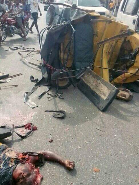 Graphic: Trailer crushes tricycle driver to death in Imo State, destroys many shops
