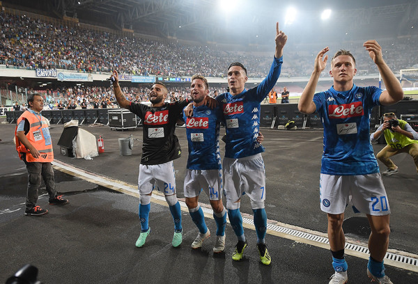 Players of SSC Napoli celebrate the victory after the serie A match between SSC Napoli and AC Milan at Stadio San Paolo on August 25, 2018 in Naples, Italy.