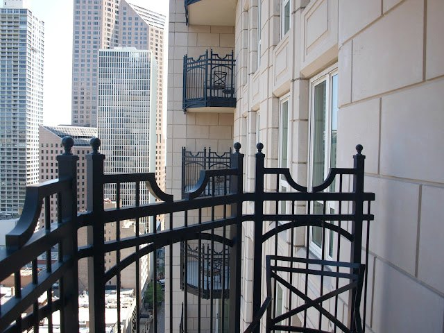 Limestone facade and iron balcony at Waldorf Chicago by Hello Lovely Studio