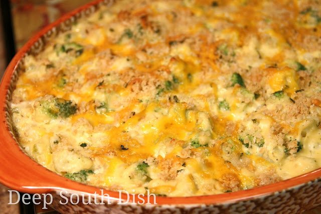 A casserole made with fresh broccoli and cauliflower, in a simple butter roux-based white sauce made with The Trinity, a little cheese in the base, and topped off with those buttery crackers we all love so much... and a little more cheese.