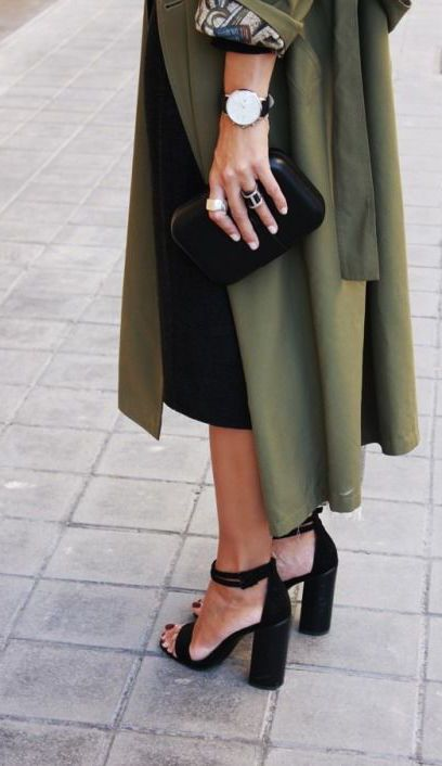 olive green coat with black heels and handbag chic fashion style