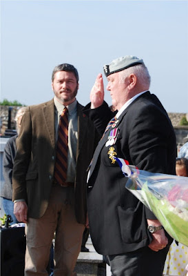 David looks on as John salutes after laying the wreath