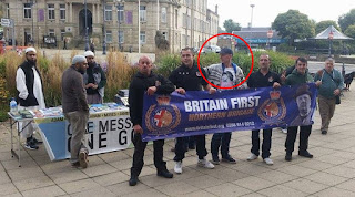 Tom Mair holding Britain First banner