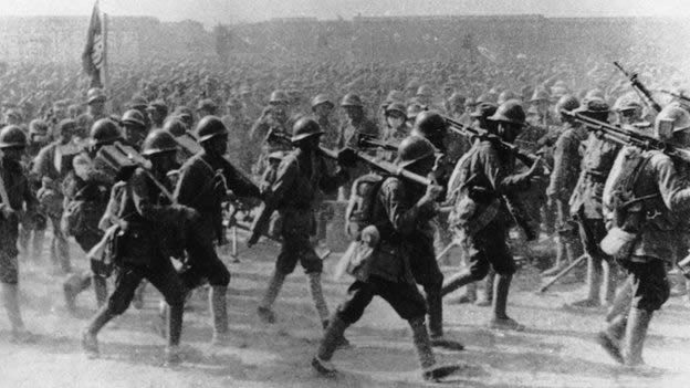 Chinese Red Army soldiers march on Shanghai in 1949
