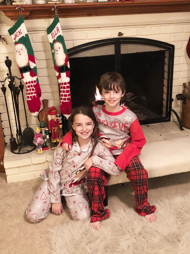 boy girl twins in elf on the shelf pajamas