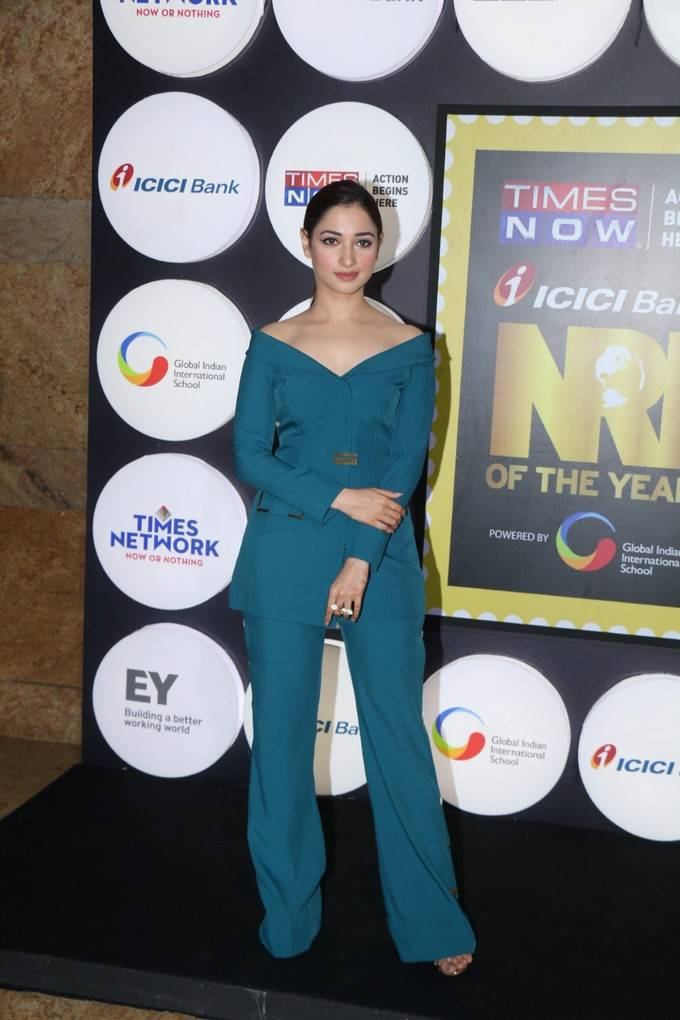 White Beauty Tamanna In Green Dress At NRI Of The Year Awards