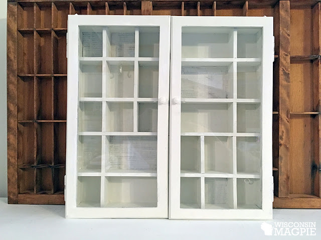 white wall-mounted curio cabinet