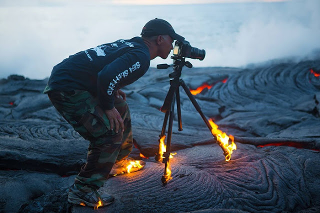 15 Crazy Photographers Doing ANYTHING For The Perfect Shot