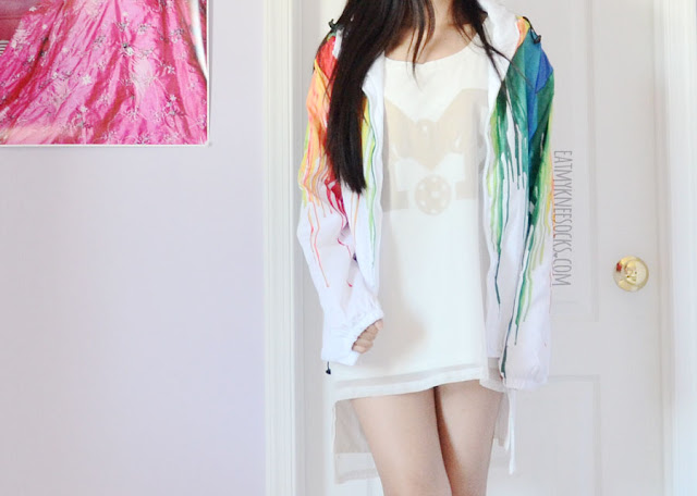 Rainbow watercolor paint splatter printed white windbreaker jacket from Romwe, perfect for rainy or windy days with its bold, vibrant design.