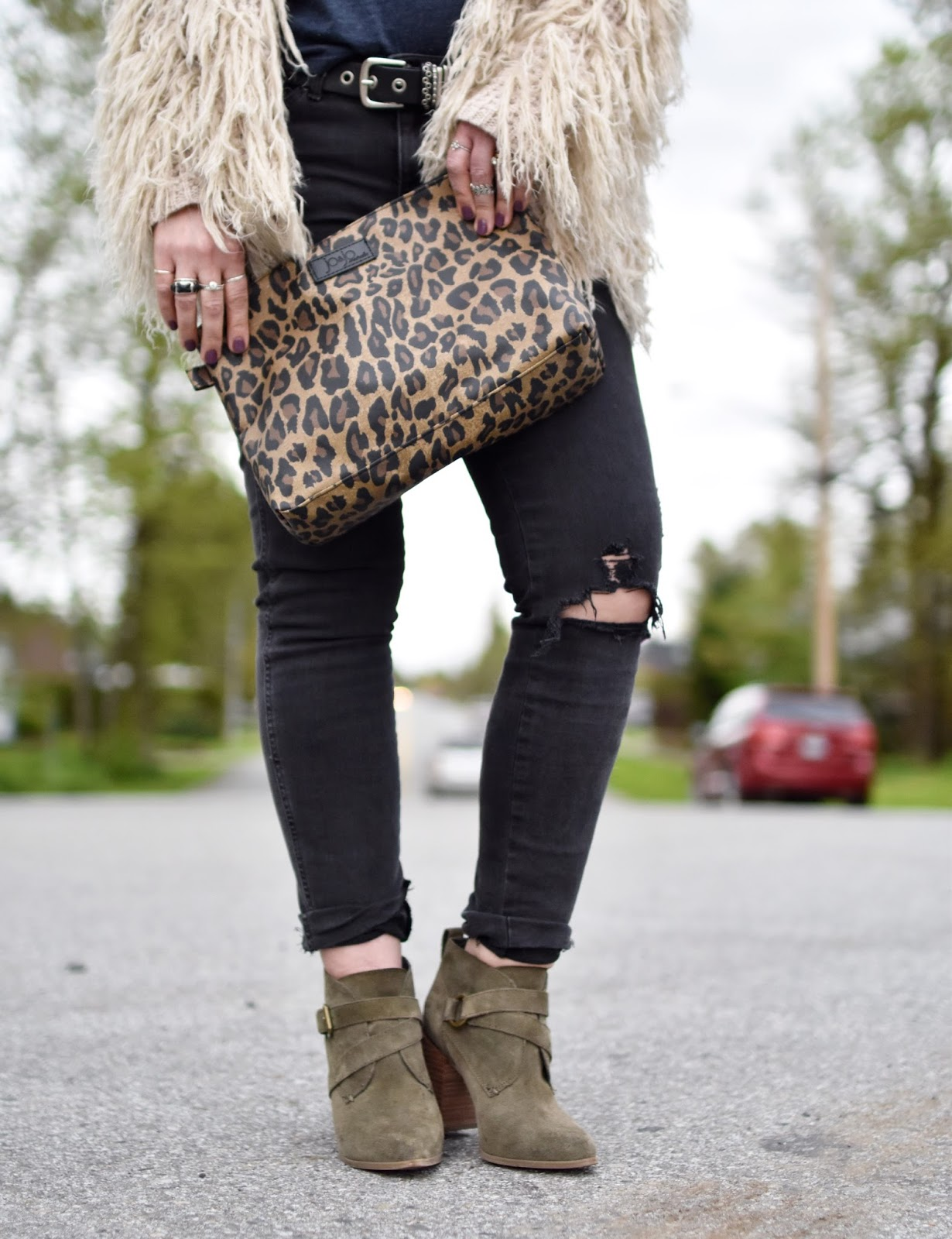 Monika Faulkner outfit inspiration - black skinny jeans, shaggy cardigan, olive suede booties, leopard-patterned pouch