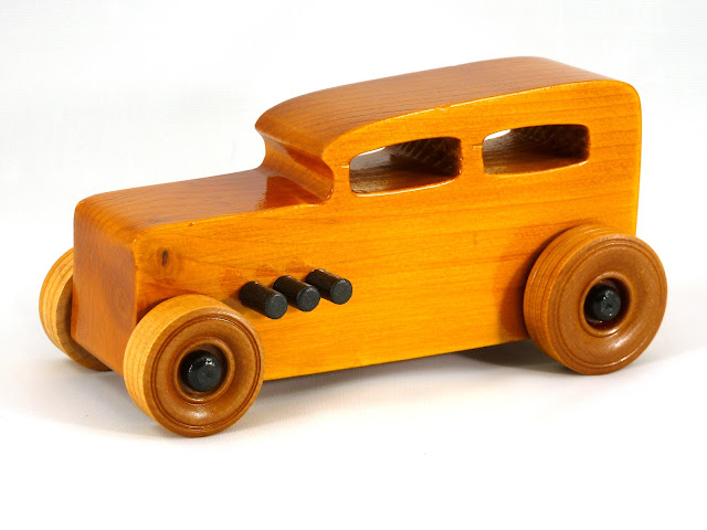 Left Front Wooden Toy Car - Hot Rod Freaky Ford - 32 Sedan - Pine - Amber Shellac - Black Pipes - Black Hubs