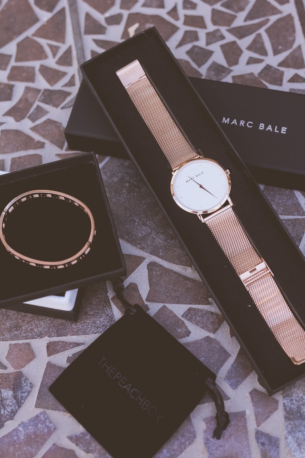 Liana of @findingfemme wears rose gold Marc Bale watch from The Peach Box