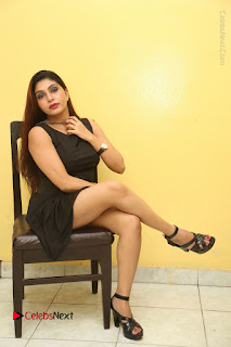 Tollywood Upcoming Actress Pooja Roshan Stills in Black Short Dress at Plus 1 Movie Trailer Launch  0320.JPG