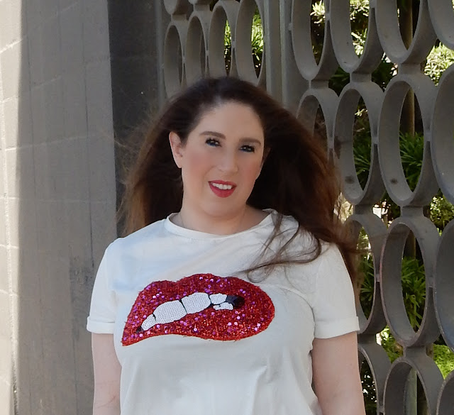 Marisa Stewart styles a graphic top with sequined lips for her blog the high heeled brunette