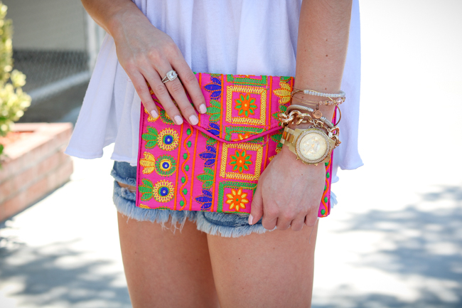 white free people tee hot pink embellished clutch