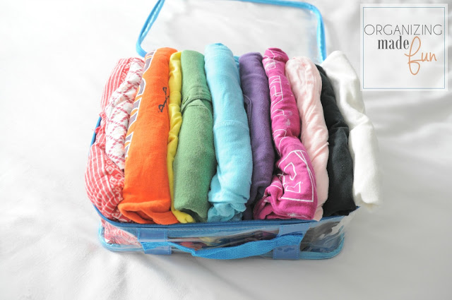 Use sturdy packing cubes to organize shirts for easy travel :: OrganizingMadeFun.com