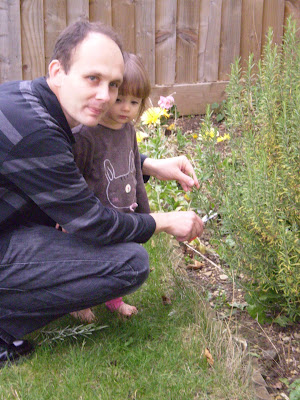 Chef and Sous Chef chop rosemary in the garden