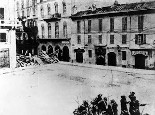 Rioters mounted barricades when troops were sent to quell the food riots in Milan in the late 1890s