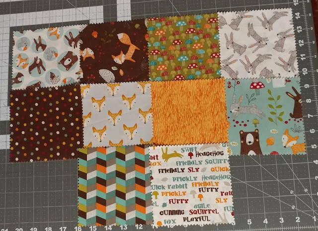 Precut fabric woodland charm squares from Hobby Lobby