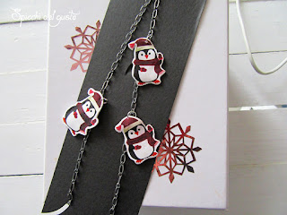 Collana con pinguini con pellicola termoretraibile