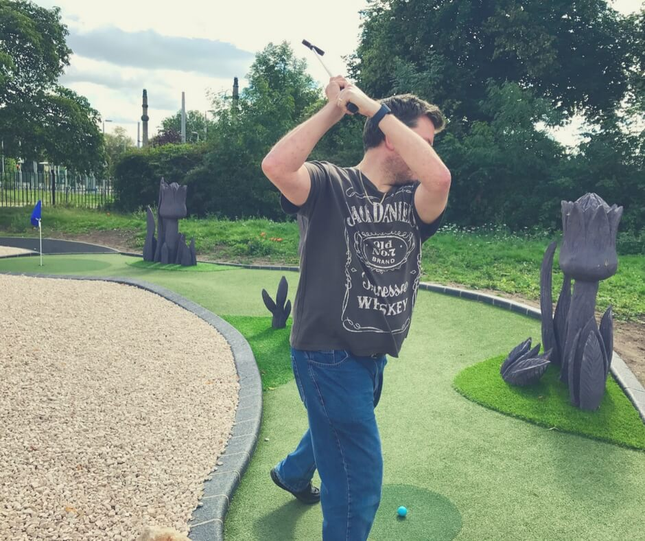Man in the middle of a golf swing