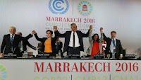 UN climate chief Patricia Espinosa, second from left, Morocco's foreign minister Salaheddine Mezouar, centre, and Council of Europe goodwill ambassador Bianca Jagger, seconf from right, celebrate after the proclamation of Marrakech. (Credit: Reuters) Click to Enlarge.