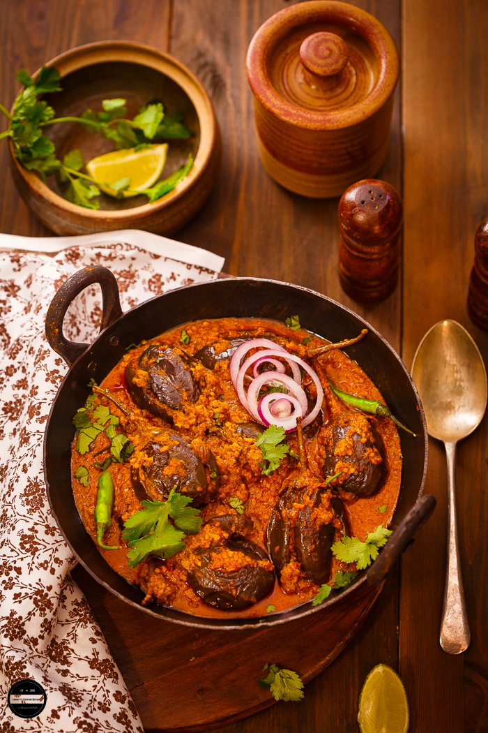Baingan Bhatinda Masala, A delicious curry prepared with purple round aubergine, cooked with freshly ground garam masala with basic ingredients. A perfect spicy and finger licking curry that goes well with roti or rice.