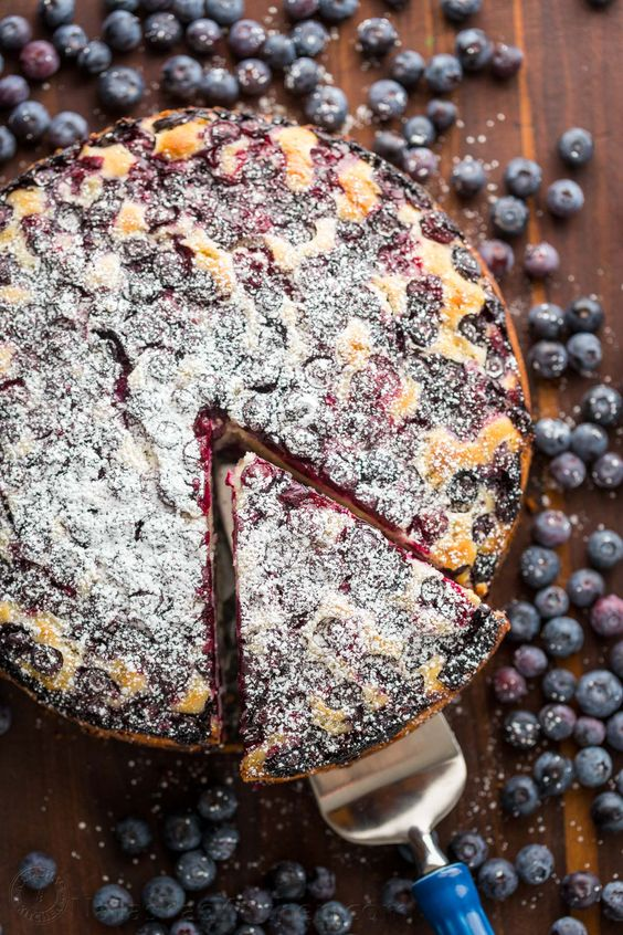 This Blueberry Lemon Cake is loaded with 1 pound of blueberries and every bite has sweet pops of juicy blueberry and fresh lemon flavor. It's not too sweet and not too tangy, but just right. This is my favorite tea/ coffee lemon blueberry cake and it's easy, easy, easy!!