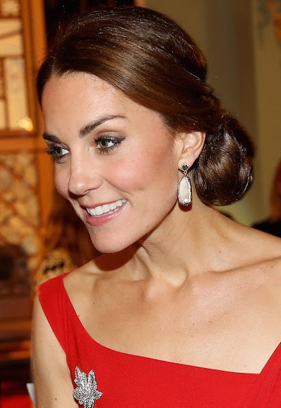 Kate Middleton wore Preen Finella Satin Midi Dres, Baroque Pearl Double Sided Earrings by Soru Jewellery,  Jenny Packham 'Casa' clutch, Gianvito Rossi pumps