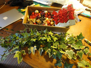 Ivy branches with box of Christmas deorations