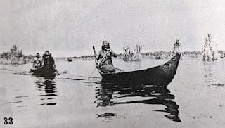 Madan paddling canoes