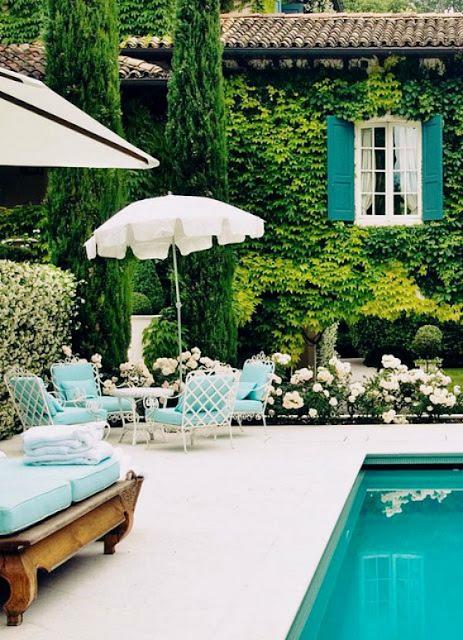 glamorus outdoor space with swimming pool via Belle Vivir Blog